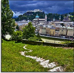 Let's Take a Walk and Say Goodbye to Salzburg (Nathan Bergeron Photography) Tags: trees salzburg grass architecture clouds geotagged austria interestingness artist view rooftops path unesco worldheritagesite walkway getty viewpoint oldtown steeples picks montains thesoundofmusic collegiatechurch stfrancischurch baroquearchitecture kollegienkirche franziskanerkirche explored salzachriver yearinfrance churchofstblasius 18122009 geo:lat=47801737 geo:lon=13046683