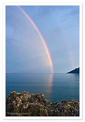 Rainbow, Skoutari, Mani, Greece (Christos Andronis) Tags: blue light water colors canon landscape 350d rocks pastel mani greece peloponnese     lakonia
