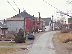 me_nb03m092 Streets of Eastport, Maine 2004 (CanadaGood) Tags: usa house color colour building 2004 me america pavement maine powerlines streetphoto eastport 2000s canadagood