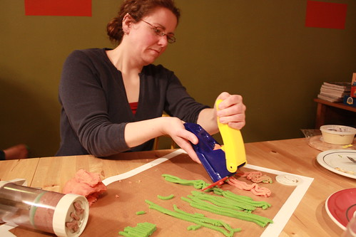 Jess squeezes pixels from a Play-Doh Fun Factory