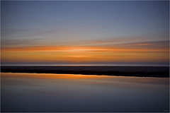 Lagoon, Druridge (JeremyRambles) Tags: sea england sky seascape reflection pool dawn coast lagoon northumberland shore druridge landscapephotography presunrise intensecolour sunbelowhorizon jp2009