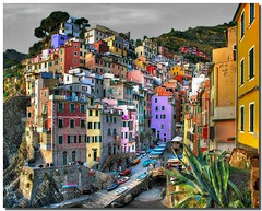 The famous colorfull village (Nespyxel) Tags: italy colors architecture boats bravo colorful italia colours village liguria vivid cinqueterre maestro colori riomaggiore laspezia paese nespyxel stefanoscarselli pleasedontusethisimageonwebsites blogsorothermediawithoutmyexplicitpermissionallrightsreserved