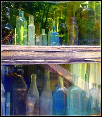 Bottles in the Window with Reflections (Stephanie'sBestShots) Tags: wood painterly window closeup reflections amber photo shine bottles angles blues greens translucent layers transparent luminous depth bluse twop abstact blueribbonwinner lovelylovely