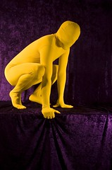 Yellow on Purple Six (AnonymousArt) Tags: selfportrait art me lines yellow fetish self person purple bright artistic body shapes vivid surreal suit human fabric material form tight exploration nylon spandex lycra catsuit skintight enclosed encasement formfitting zentai secondskin anonymousart
