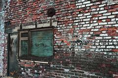 storefront (klausness) Tags: door uk england brick window newcastle decay photowalk flickrmeet newcastleupontyne ouseburn xti canonefs1755mmf28isusm 400d