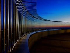 don't jump (werner boehm *) Tags: sunset reflection fence germany munich mnchen bayern bavaria tv bars perspective bluehour zaun spiegelung tvtower perspektive gitter dontjump abendrot stbe wernerboehm blauestundefernsehturmolympiaturmolympic