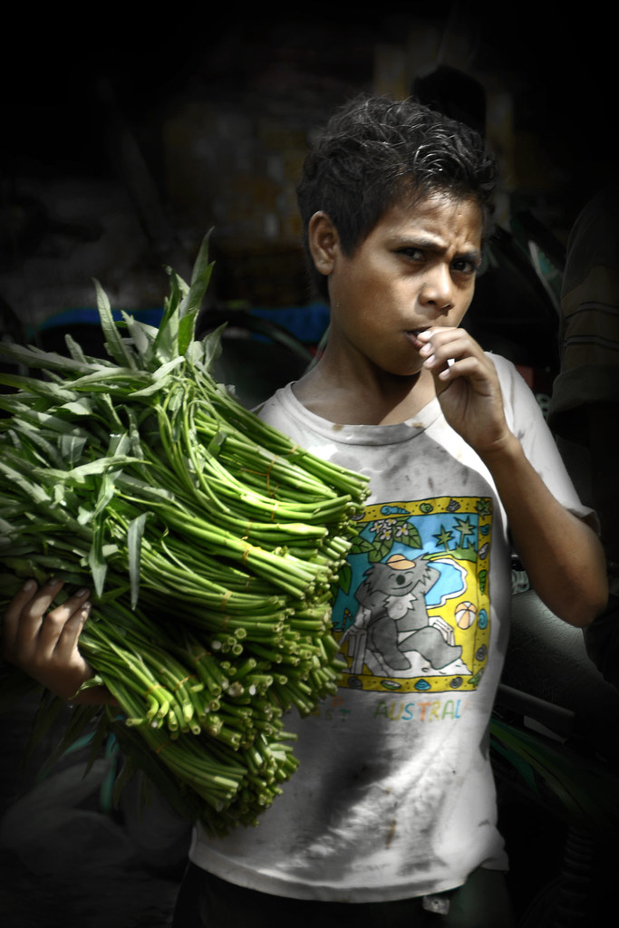Kupang, West Timor - Boy selling vegitable