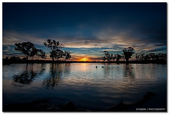 Sunset At The Katoomba Pond (Sam Ili) Tags: park sunset sky sun color reflection water silhouette clouds canon pond harrison australia canberra dri hdr act gungahlin explored 450d canberrasunset canon1022mm3545