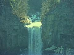 Sunlight Highlights Source Of Taughannock Falls (Birder23) Tags: light cliff newyork creek bowl whirlpool gorge heights fingerlakes thaw exciting shimmering shale weathering taughannockfalls newyorkstatepark icechunks waterfallsofnewyorkstate icewalls upperoverlook