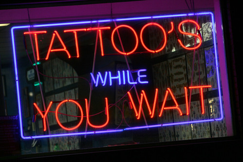 "I think Charlie got tired of people leaving their body parts to get tattoos and not coming back to get them, so he had to advertise ""Tattoos while you wait"""