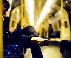 Lost In Yellow (*junket*) Tags: uk london film yellow mediumformat underground shoes legs bokeh tube strangers 120film 2009 105mm f24 pentax6x7 pentax67 pro800z smctakumar autaut fujifilmpro800z ©dannyzveglicallrightsreserved