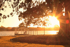 Late Afternoon in Autumn (Amanda J Richards) Tags: sunset sky tree water leaves landscape jetty estuary trunk peel sunrays mandurah