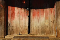 2009:02:21__15:49:42 (MilkaWay) Tags: door wood light shadows lock warehouse textures nails 365 2009 day52 threshold cottongin redpaint fadingpaint aphotoaday bostwick morgancounty ruralgeorgia assignmentwood p3652009