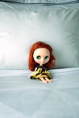 just a little doll in a big big bed