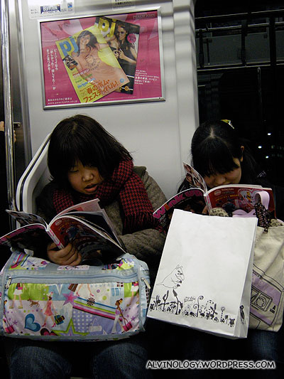 These two Japanese girls really love their magazines