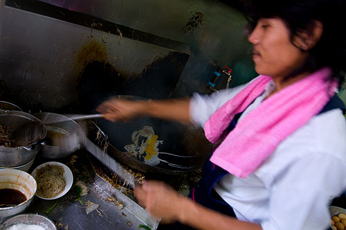 Frying noodles at Nay Lao, a restaurant in Bangkok
