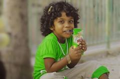 innocence (i b u) Tags: park smile face fun kid child milo daughter 123 321 drinks care joyful maldives ibu curlyhair gree colorcontrast childrenpark loughter outdoorportrait greencolor twtme ibrahimmohd ibumohd maldivesibusadventure day365project