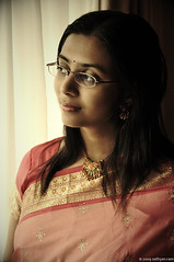 Through her eyes... (sathyan.ram) Tags: lighting wedding woman window beautiful smile lovely potrait staring saree leena potraiture softtones