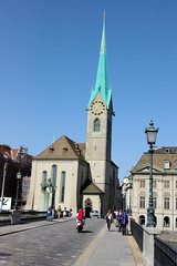 Zurich Scene (cwgoodroe) Tags: blue roses summer church water fountain switzerland ancient europe arch swiss zurich gothic sunny german column archway waterway doric carvedstone christion suiess