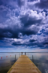 the watchers (Adam Pniak) Tags: sea sky people clouds pier skies cloudy jetty dramatic poland stormy balticsea baltic quay buoys watchers rzucewo inspiredbylove buoyant colorsofthesoul