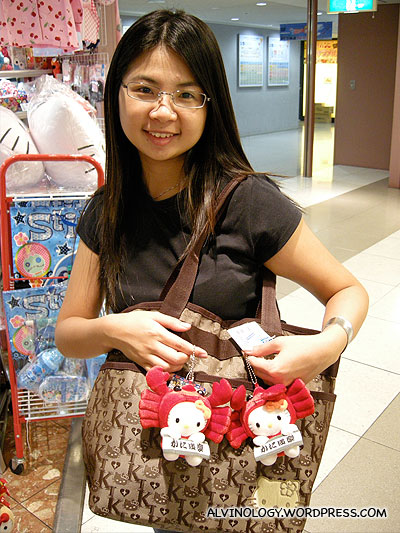 Meiyen trying to steal some Hello Kitty toys
