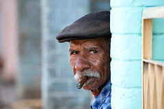 The cigar smoker of Viales, Cuba (alschim) Tags: ocean street old city travel blue sea summer vacation portrait sky people mountain black color tree men green tourism beach nature water face closeup vintage geotagged outdoors island person leaf sand nikon day background smoke traditional havana cuba cigar tourist palm unesco hills communism human castro american latin tropical caribbean relaxation cuban habana tobacco pinar kuba ethnicity viales peopleofcuba pinardelro vialesvalley d700 flickraward wwwalschimde menscheninkuba nikkor7003000mmf4556