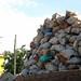 Minaret and mound of rubbish