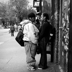 Face to Face (antonkawasaki) Tags: nyc newyorkcity blackandwhite bw intense streetphotography squareformat backpacks lesbians facetoface twogirls iphone youngwomen 500x500 againstthewall facingeachother stphotographia antonkawasaki