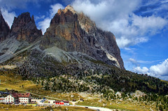 Sassolungo Scale! The Dolomites (sminky_pinky100 (In and Out)) Tags: life travel blue trees red sky italy mountains green grass rock clouds buildings landscape high scenic meadows paths picturesque rugged dolomites personalbest 5photosaday touristdestination sassolungo bej abigfave omot citrit eyejewel overtheexcellence theperfectphotographer goldstaraward damniwishitakenthat vosplusbellesphotos paololivornosfriends