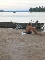 Sitting and reading (vattelapeska) Tags: beach river sand sitting laos mekong siphandon dondhet earthasia