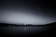 Twilight Glow (Jeff Engelhardt) Tags: seattle city blue red blackandwhite bw moon white black building water monochrome skyscraper marina canon boats harbor haze downtown cityscape post ships filter jethro gasworks lakeunion selenium skyling 40d jeffengel jeffengelhardt montanajeff fjasinpiglatinforjeff