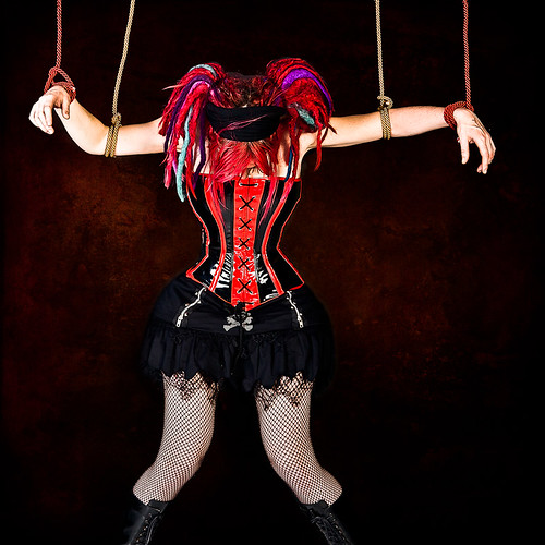 Puppet Doll by the Strings by Toni Wallachy