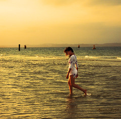 Walk of Life (Nika Fadul) Tags: light sunset sea orange woman mist beach girl walking wind blow monicafadul nikafadul