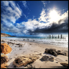 The Battle of the Bright Sun & the Dark Clouds :: HDR :: Vertorama (Artie | Photography :: I'm a lazy boy :)) Tags: sunset sea sky reflection beach water clouds photoshop canon dark sand rocks cs2 tripod australia wideangle shore adelaide poles 1020mm southaustralia remains hdr corals foreshore oldjetty artie 3xp sigmalens photomatix tonemapping tonemap 400d wilunga rebelxti portwilunga