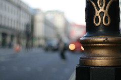 london bus and pedestrian (!!) (_nejire_) Tags: street uk red england black blur building london station strand canon eos 50mm kiss bokeh britain taxi pedestrian 8am londonbus 10faves nejire 400d eos400d canoneos400d kissx fave10 mhashi planart1450ze nearcharingcrossstation