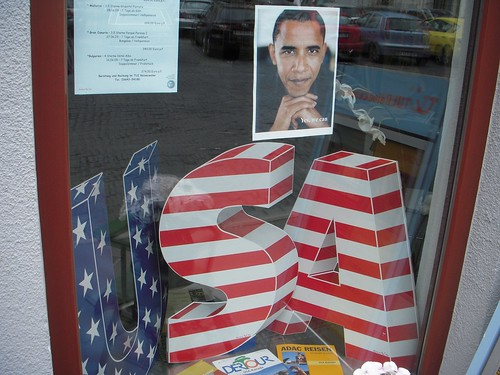 The travel agent has a generic USA promotion, but presto, a picture of Obama with the message Yes, We Can makes it welcoming.