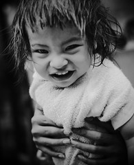 Little Girl covered with bath towel (Kaz.MO) Tags: portrait bw white black girl smile kids children thailand bath peace child hand bangkok towel g1