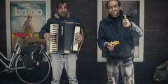 The Musicians (Guido Musch) Tags: portrait musician music cinema netherlands bike bag nikon homeless nederland streetportrait accordion explore friendly groningen tambourine bruno easteurope pathe ornot iguess d40 sachabaroncohen redsaddle guidomusch vivitar28mm25 iguesstoo thefirstonewhoseeswhatthesimilaritybetweenthisphotoandthesalesmaniswinsaprice