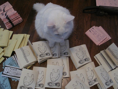 Nilla helping me cut and staple zines.