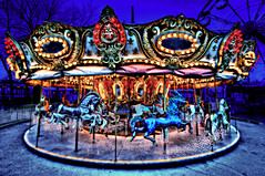 Fantasy Carousel Dream (Surrealize) Tags: seattle park carnival blue winter red horses black reflection tree face silhouette yellow glitter night silver grate gold lights mirror amusement washington nikon colorful ride clown lion dream surreal carousel sparkle trail fantasy ferriswheel jewels merrygoround hdr stallion saddles seattlecenter gallop carnie hooves fantastical prance 9exp d700 pixydust surrealize