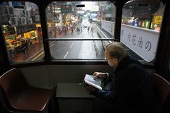 Endangered Species (briyen) Tags: street old city people urban man rain hongkong reading book alone photos tram hong kong streetphoto  trolly flickrchallengegroup flickrchallengewinner thepinnaclehof kanchenjungachallengewinner kanchenjungawinner tphofweek191