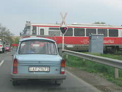 Trabant at a Railway Crossing - A flash back to the past ? Alsonyek, Hungary (ilcavaliereinglese) Tags: road railroad car train hungary crossing transport rail railway east german trabant  tolna  alsonyek batasyek