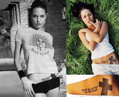 Angelina Jolie Black Cross tattoo. Gothic letter tattoo between her shoulder