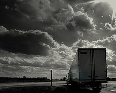 Truckers on the move .....  Hwy 41 (**Ms Judi**) Tags: road sky blackandwhite sun sunlight beautiful wisconsin clouds truck shine awesome dramatic explore trucks redlight magical taillight spotcolor rosepetal comingandgoing hwy41 selectivecoloring explored msjudi peshtigowisconsin judistevenson truckersonthemove powerfulclouds