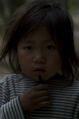Little girl - Vietnam (Man needs to be told) Tags: mountains cute hair bigeyes asia vietnamese child poor posing dirty vietnam messy littlegirl sapa snotty unkept stripytshirt