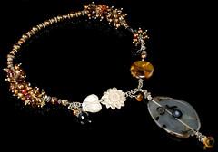 SunSeed circle on blk 0381 (jbEbert) Tags: brown yellow necklace jewelry sunflower mauve pearl citrine smokeyquartz mossagate balisilver jbebert