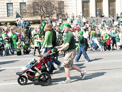 POPS taking his kid for a ride. (kennethkonica) Tags: sunglasses beads shoes smiles parades shades shorts earrings crowds stpatricksday carriages bowties berets indianalottery