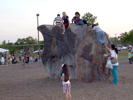 Climb the rock.