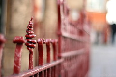 Katia's fence [3] (_nejire_) Tags: red england london canon fence eos kiss bokeh 14 explore railing fp frontpage 3pm carlzeiss redfence 30faves fave20 50faves 10faves 20faves 40faves nejire 400d eos400d canoneos400d kissx fave10 fave30 fave50 mhashi fave40 carlzeissplanart1450ze katiasfence 2222954815am