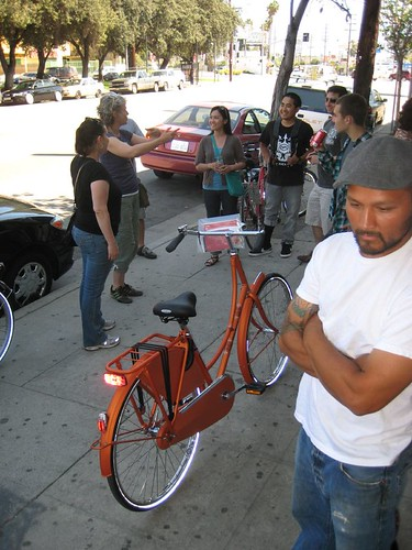 Orange Old Dutch Batavus bicycle in front of Flying Pigeon LA.